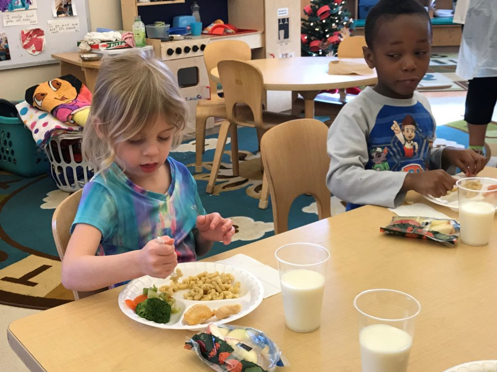 Pre-K students at Day Early Learning at Ft. Harrison eat a balanced lunch together