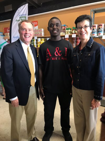 Mayor Hogsett smiles with an A & I employee and Jump IN CEO Julie Burns